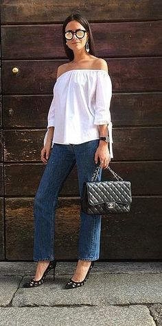 100% authentic be0ed cf8ae Off-the-shoulder top, straight-fit jeans, and a quilted Chanel