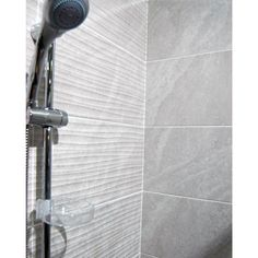 25x50cm Ditto Light Grey Wave by BCT ceramic wall tile with a wave pattern also comes in a flat field tile and matching floor tile.