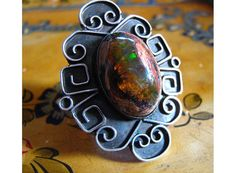 Fire opal and silver ring...