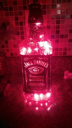 My diy lights in a bottle :) it makes a pretty cool night light in my kitchen. When we get a house, my kitchen will seriously be jack daniels theme! Jack Daniels Party, Jack Daniels Gifts, Apt Ideas, Kitchen Themes, Liquor Bottles, Summer Diy, Room Themes, Bottle Crafts, Mason Jars