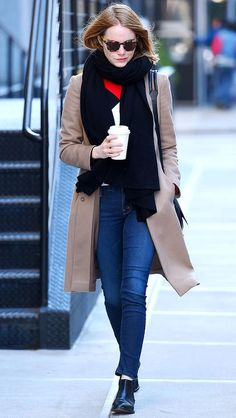 Emma Stone in skinny jeans, black booties, and a camel coat - click ahead for more fall outfit inspiration