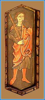 La figura siguiente representa a un hombre de pie vestido con saya azul oscuro y calzas y manto rojo recogido en su mano izquierda y empuñando una espada larga en la derecha que apoya en el hombro.