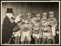 """1930s  Way before there even was such a thing as """"cosplay"""", and it was """"just some people dressing up in costumes because it's fun"""", these gents in 1930s Serbia made a paddling of Donald Duck costumes from whatever was lying around. It's decent handiwork for the time, but it's a little horrifying these days.  (viaiheartchaos)"""