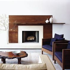 Love this modern/earthy look for the fireplace. possibility in family room? A modern fireplace instantly become a breathtaking focal point for any room, but with new advances in energy efficiency. See the best designs about fireplace ideas Living Room New York, Fireplace Surrounds, Wooden Wall Panels, Living Room With Fireplace, Contemporary Living Room, Wood Fireplace, Fireplace Design, Modern Fireplace, Interior Design