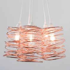 The Spiral Nest Cluster 5 Light Chandelier is a fortuitous accident born from a scribble in an artist's notepad.