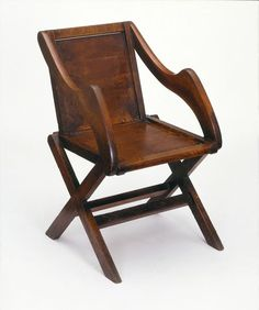 Arts and Craft's Glastonbury type chair  made around 1840, and designed by Augustus Pugin.