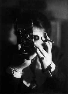 © Germaine Krull, Self-portrait with Ikarette, 1925