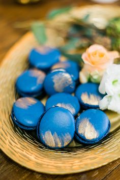 bright blue and gold painted french macarons