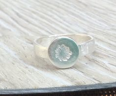 A personal favorite from my Etsy shop https://www.etsy.com/ca/listing/479053975/silver-dandelion-ring-dandelion