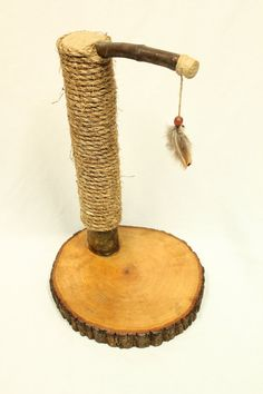 Follow the link to handmade cat scratching posts! https://www.etsy.com/listing/179531570/recycled-tree-limb-cat-scratching-post?