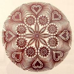 Intricate brown Polish paper-cut.