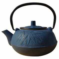 "Cast iron tetsubin teapot with a bamboo motif.   Product: TeapotConstruction Material: Cast ironColor: BlueFeatures:  20 Ounce capacityStainless steel infuser included Dimensions: 6.5"" H x 6"" W x 5.25"" D"