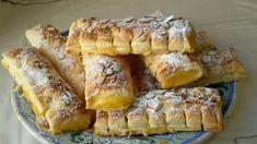 Cañas de crema con masa de hojaldre. Una receta de cocina casera con la que preparar napolitanas o cañas de crema. Fáciles y deliciosas.