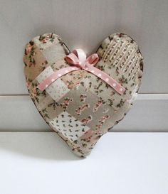Here is a lovely shabby chic heart, made with a lovely patchwork material...