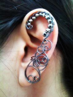 Oh, gosh. Love. This. Though, it'd have to be for the right ear. My left has piercings in the upper part