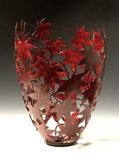 RACH!!  I saw this and thought it could be a great beginning idea for a clay cutout vessel project??  Japanese Maple Leaf Vessel