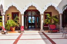 Hacienda Corazon Courtyard Arches Leaving To Oceanside Living Room