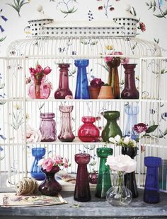 colorful glass in a birdcage -- how clever!