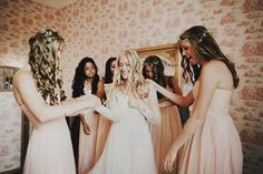We Love Everything About This Bride's Dreamy Look #refinery29  http://www.refinery29.com/green-wedding-shoes/22#slide-1  We can't tell what's more beautiful: that antique wallpaper, or these bridesmaids' dresses and flower crowns. It's safe to say this is going to be one picture-perfect day.Photography: Logan Cole Photography....