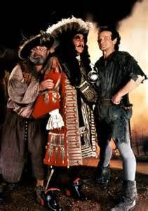 Bob Hoskins as Smee; Dustin Hoffman as Capt James Hook, and; Robin Williams as Peter Pan in 'Hook'