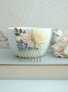 Hey, I found this really awesome Etsy listing at https://www.etsy.com/listing/159583659/grey-and-pink-flower-comb-ivory-pink