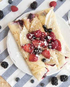 These delicate crepes are rolled up with a fluffy cream cheese filling and sliced strawberries. Make these as a dessert treat during strawberry season, or for a fancy weekend brunch. Crepe Recipes, Brunch Recipes, Breakfast Recipes, Dessert Recipes, Mexican Breakfast, Pancake Recipes, Waffle Recipes, Breakfast Sandwiches, Breakfast Pizza