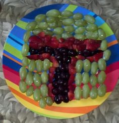Boba Fett fruit tray: green grapes, strawberries and blueberries.