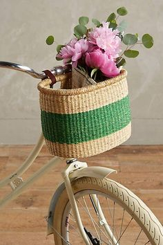 Mostly I just love the flowers in this basket --> Ghanian Bicycle Basket #anthrofave #anthropologie