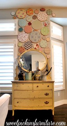 For anybody who loves fabric design, what a great way to enjoy the art...embroidery hoop wall
