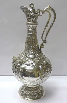 Irish Victorian Silver Armada Jug  A magnificent large antique sterling silver wine jug of elegant shaped form on pedestal foot.  Weight 1387 grams, 44.5 troy ounces. Tall height 38 cms. Diameter of foot 12.5 cms. Dublin 1877. Maker John Smith. - http://www.waxantiques.com/items/6475%20Irish%20Victorian%20Silver%20Armada%20Jug/6475.htm