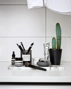 We've lived through the succulent phase. It's time to welcome cacti into our lives (as seen at Trendenser). You can have them little or big, but in any size, they bring a cheerful burst of green into a monochrome world.   - ELLEDecor.com