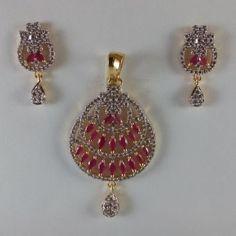 Buy designer pink & white gold tone pendant set at haveaclick
