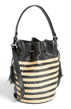 Smooth leather trim refines a drawstring bucket bag crafted from striped raffia for a dose of earthy, vintage-inspired sophistication.  Drawstring closure. Optional, adjustable crossbody strap. Interior zip, wall and cell-phone pockets. Signature print lining. Textile with leather trim. By Loeffler Randall