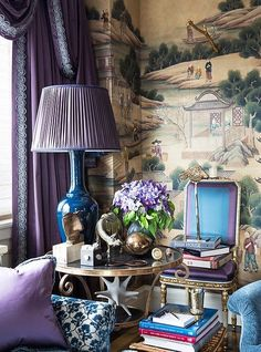Inside the stunning home of the Ultimate A-list decorator: Alex Papachristidis. A gilded table that belonged to the designer's mother houses a collection of treasured objets. The inky-blue glazed lamp was created by Alex for Christopher Spitzmiller. Photo by Lesley Unruh. One Kings Lane Designer Houses.
