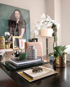 feminine office, pink walls, white orchid in gold pot, pink desk chair, glass tray, layered art