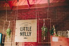 love this DIY signage out of copper pipes and hanging plants
