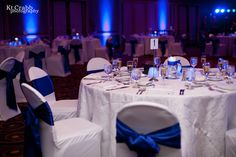 White Table Linens, white spandex chair covers, royal blue satin sashes!