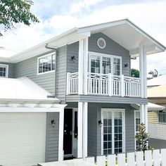 Placement of first story garage/door/windows. Gable above door and fretwork above garage Die Hamptons, Hamptons Style Homes, House Paint Exterior, Dream House Exterior, Facade House, House Roof, House Paint Color Combination, Street House, Custom Home Builders