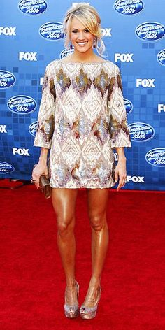 carrie underwoods dress. Her legs are a little too shiny