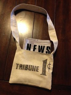 """Fabric newspaper and shoulder bag for little fella's newsie costume. The newspaper headline states, """"NEWSBOYS GO ON STRIKE.""""  This was an actual headline in the New York Tribune during the 1899 newsboys strike."""