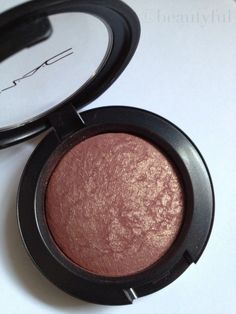 MAC Mineralize Blush in Love Joy  Looks beige in the pan, but applies pinky/plummy. I LOVE wearing this with MAC Talk That Talk.