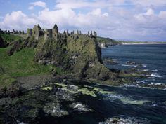 size: Photographic Print: Poster of Dunluce Castle, County Antrim by Roy Rainford : Artists The Places Youll Go, Places To See, Surfing Ireland, Castles In Ireland, Surfing Photos, Neuschwanstein Castle, Famous Castles, Ireland Travel, Ireland Uk