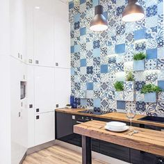 blue patchwork cement tiles in a recently renovated downtown appartement, Budapest. Designer Imre Rimóczy