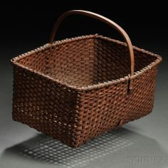 Sold for: $3,444  Shaker Woven Splint Basket, possibly Enfield, Connecticut, c. 1820, rectangular form with fixed upright bent ash handle with single notch to accommodate the rim, the rim wrapped with single lashing, the vertical splints alternately cut off and turned down on the exterior near the rim, (minor imperfections), ht. to rim 5 1/4, ht. to top of handle 9 3/4, wd. 9, lg. 11 1/4 in.  Estimate $800-1,200