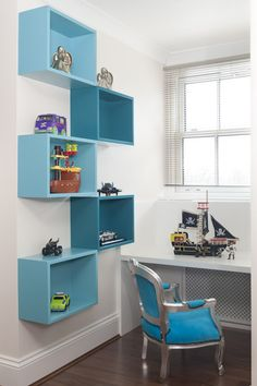 Children's room - colorful shelves (in orange, of course!)