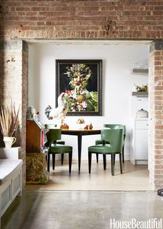 Dining space in exposed-brick walls with midcentury-modern furniture