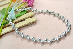 the final look of DIY pearl necklace with ribbon tie