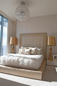 Bedroom with upholstered headboard. Ikea lighting. Fur bedding. Gold accents.