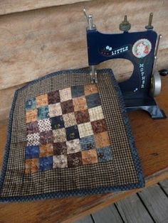 Miniature Quilts - Marian (I display my mini quilts on my mini machine just like this! Primitive Quilts, Antique Quilts, Vintage Quilts, Small Quilts, Mini Quilts, Baby Quilts, Crib Quilts, Mini Quilt Patterns, Postage Stamp Quilt