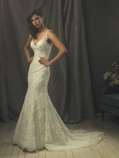 Allure Bridals' Style: C153 Colors: White/Silver, Ivory/Silver Fabric: Description: A sexy and sophisticated style in all over, lace appliqués and crystals . The dramatic v-shaped neckline features sheer illusion straps that continue to the low v-shaped back. The fitted skirt and sweep train complete this gorgeous gown.